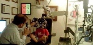boy at optometrist exam